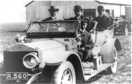 CS Rolls driving one of his cars with the Wright brothers and his chauffeur as passengers. Shellbeach May 1909.